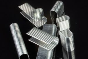 Glues for metallic staples and wire bands